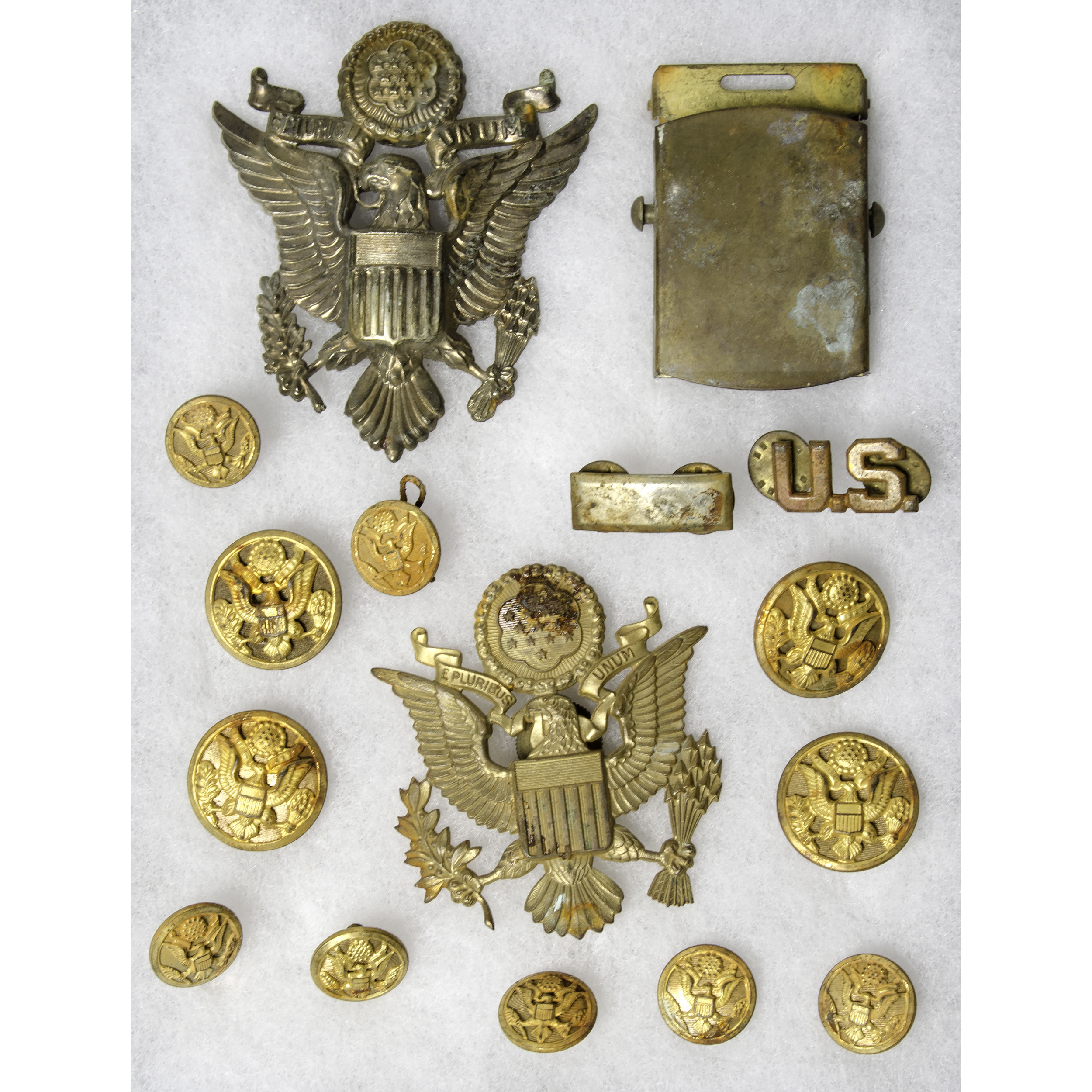 Riker Mount With WW II Hat Emblems And Buttons | Cowan's