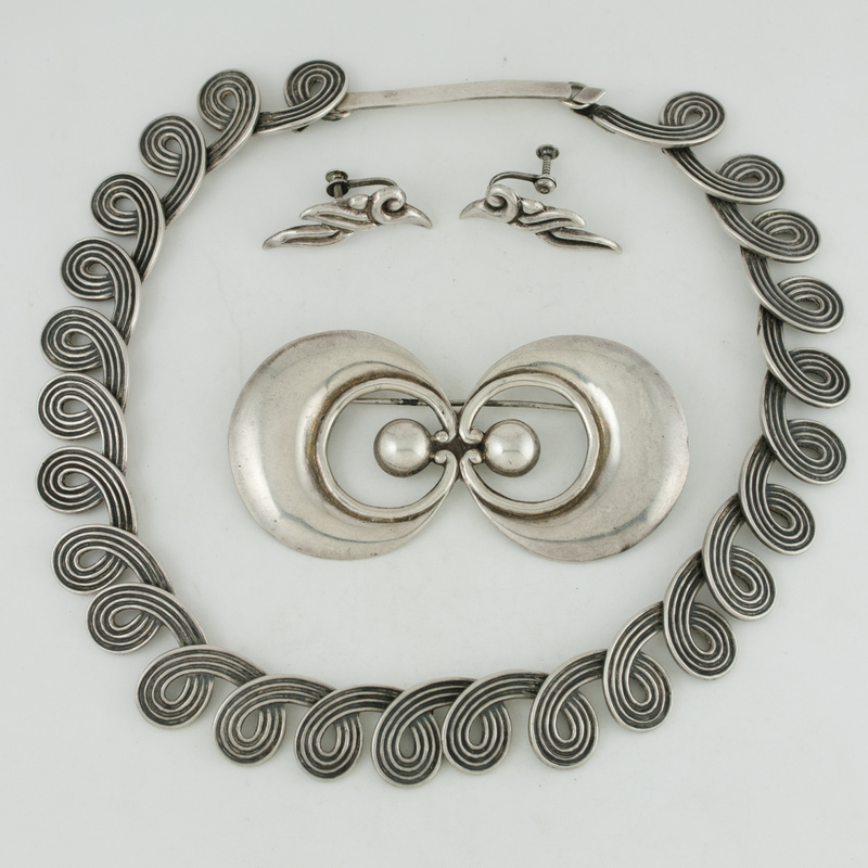 Los Castillo (Mexican, founded 1939) Silver Necklace, Earrings and Brooch