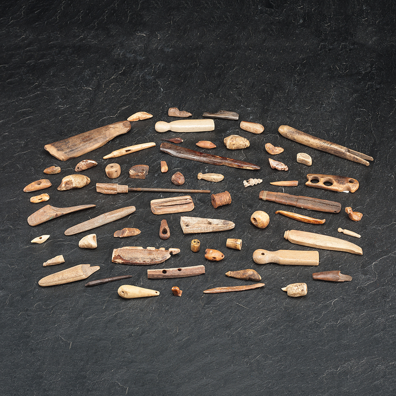 Collection of Alaskan Eskimo Bone and Walrus Ivory Tools and Gaming Pieces