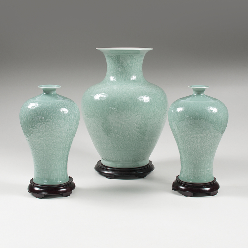 Chinese Celadon Vases With Rosewood Stands Lot Of Three Cowans
