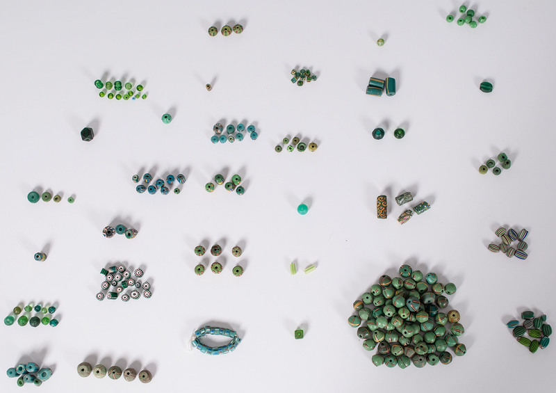 Collection of Green Colored Glass Trade Beads, From a New York Collector