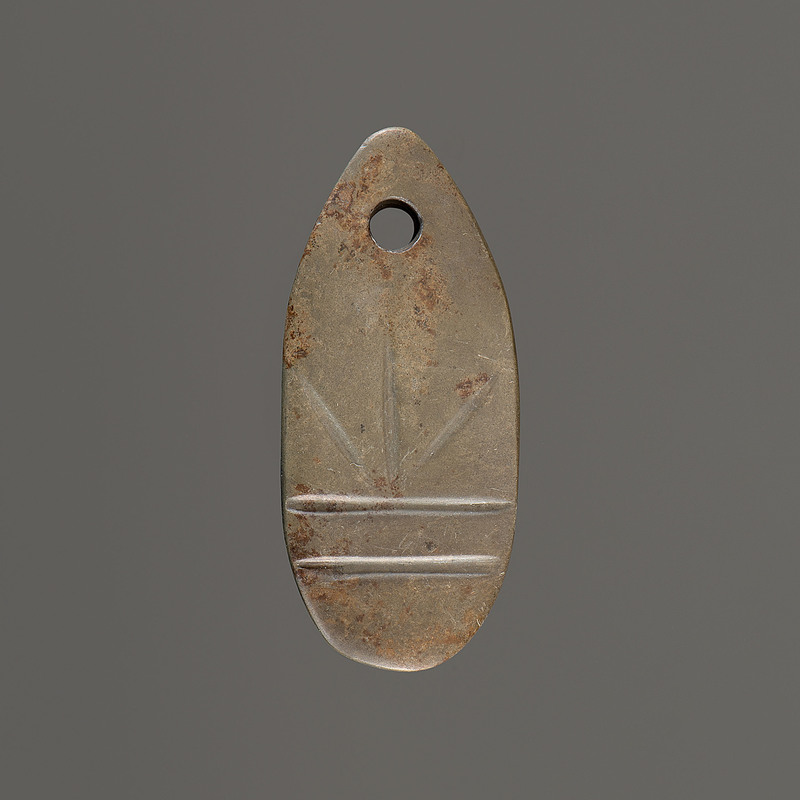 An Engraved Hardstone Pendant, 2 in.