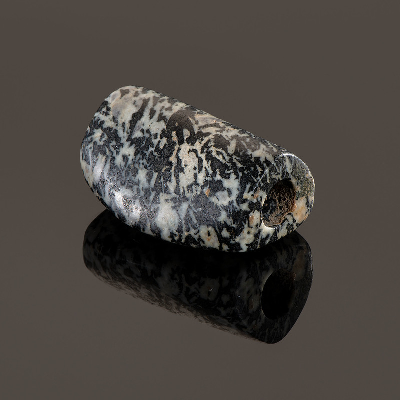 A Black and White Granite Humped Bannerstone, 2-1/4 in.