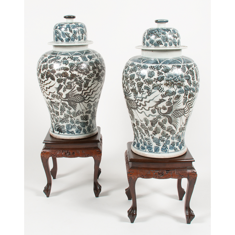 Pair of Monumental Lidded Jars with Phoenix Decoration on Hardwood Stands