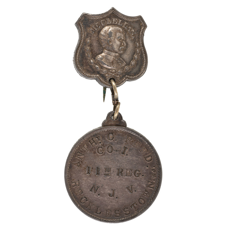 ID Disc with McClellan Pin Hanger, Anthony C. Reed, Co. I, 11th New Jersey Volunteers