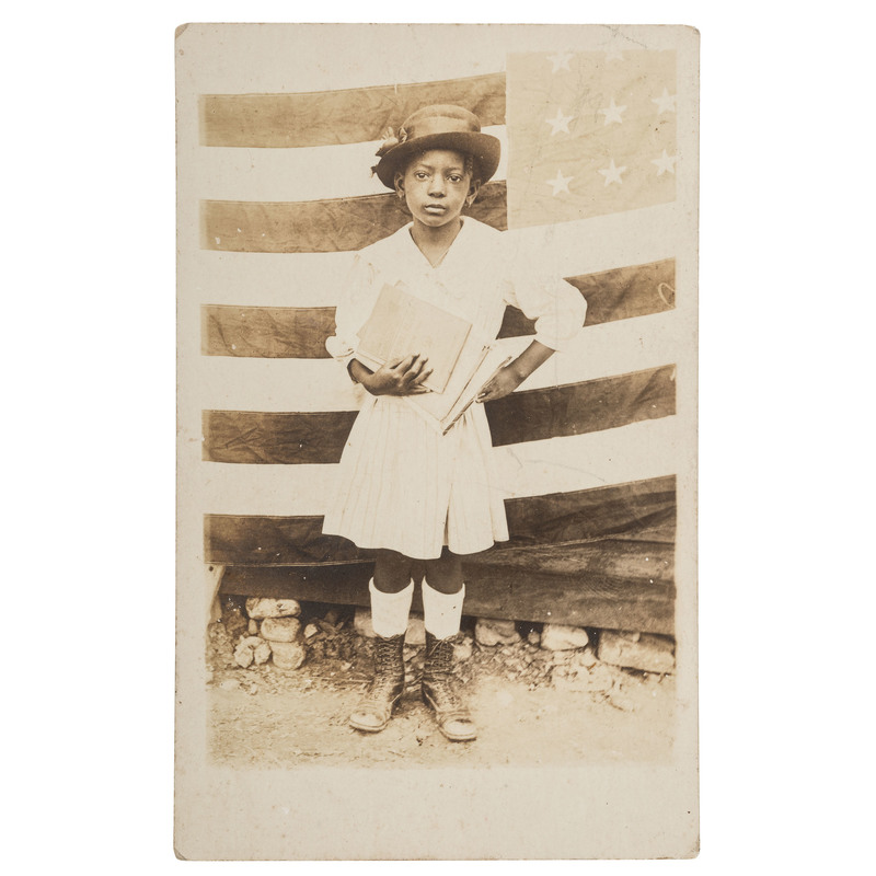 African American Girl with School Books and Flag, Real Photo Postcard, ca 1918