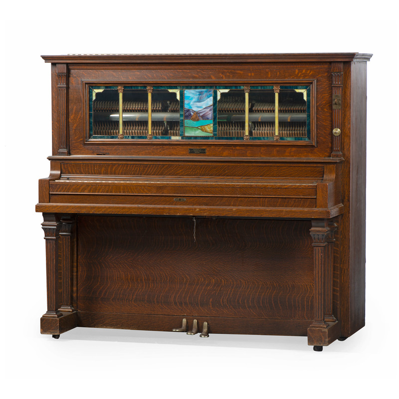 A Stain-Glass Mounted Figured Oak Coin-Operated Player Piano