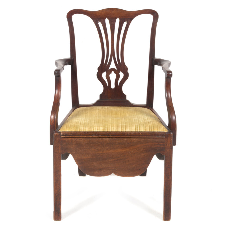 A Chippendale Carved and Figured Mahogany Convenience Armchair