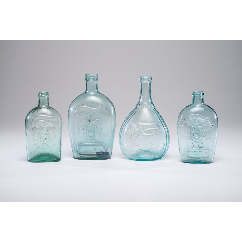 Four Aqua Blown and Molded Glass Bottles