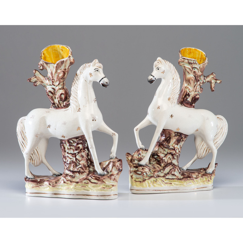 A Pair of Staffordshire Horse Spill Vases