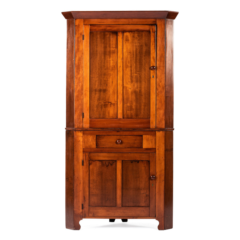 A Two Piece Paneled Cherry Corner Cupboard