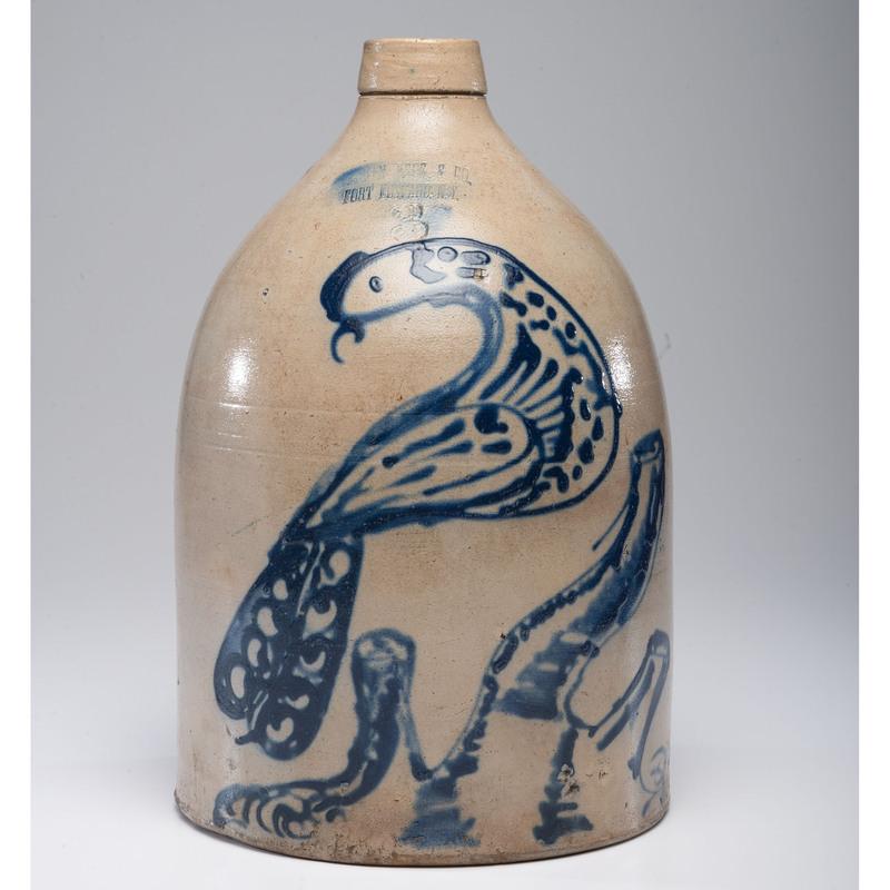 An Ottman Bros New York Three-Gallon Stoneware Jug with Bird on Stump