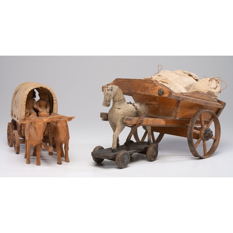 Two Carved Wood Wagon Toys