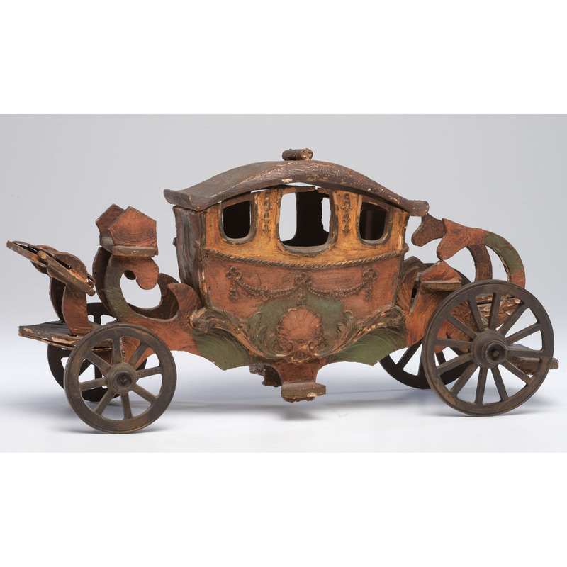 A Painted Wooden Horse Drawn Coach Toy