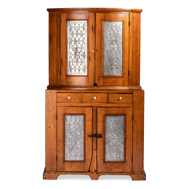 A Punched Tin Decorated Pine Corner Cupboard