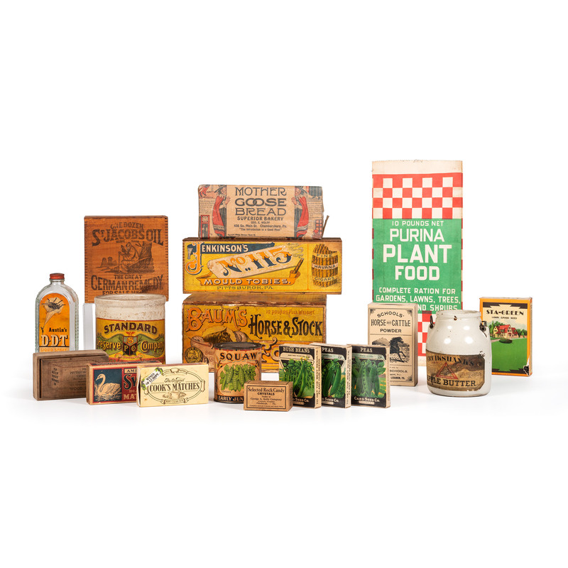 A Large Group of Advertising Boxes and Jars