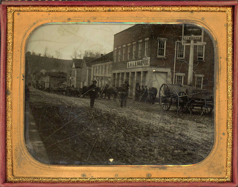 HALF PLATE AMBROTYPE OF STREET SCENE WITH SIGNS