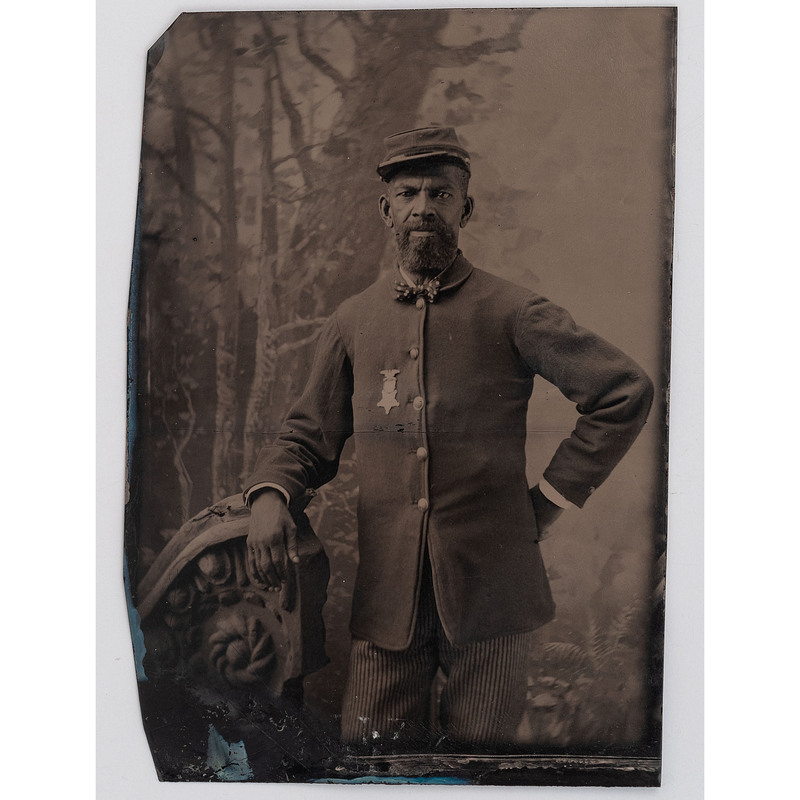 [AFRICAN AMERICANA] -- [CIVIL WAR]. Tintype of African American Civil War veteran wearing GAR badge. N.p., n.d.