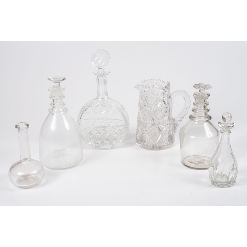 A Group of Blown and Cut Glass Decanters and Pitcher