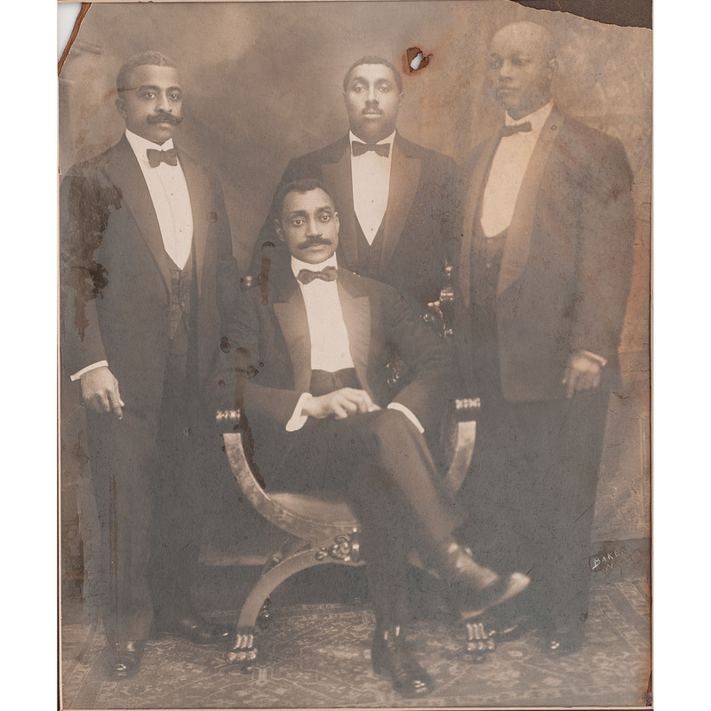 [AFRICAN AMERICANA] -- [EARLY PHOTOGRAPHY]. Oversized photograph of four African American gentlemen. New York: Baker, [ca early 20th century].