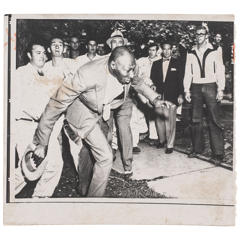 [CIVIL RIGHTS]. [COUNTS, Will, photographer]. Press photograph of African American minister being pushed by Little Rock, AR crowd after African American students entered high school. Little Rock, AR, 23 September 1957.