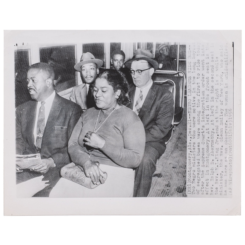 [KING, Martin Luther, Jr. (1929-1968)]. Press photograph of African American leaders riding integrated bus. Montgomery, AL, 21 December 1956.