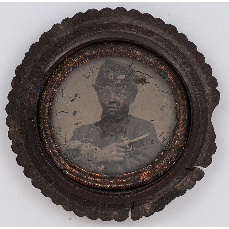 [CIVIL WAR]. Civil War gem tintype of armed African American soldier. N.p., [ca 1860s].