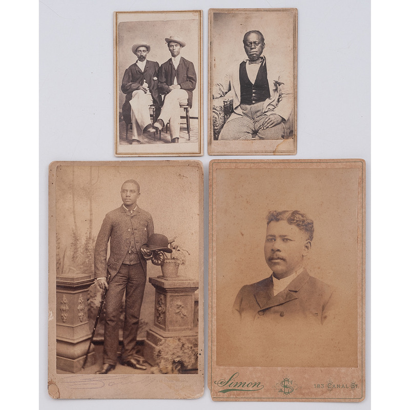 [EARLY PHOTOGRAPHY - PORTRAITURE]. A group of 4 albumen photographs of African American male subjects by New Orleans photographers, comprising:
