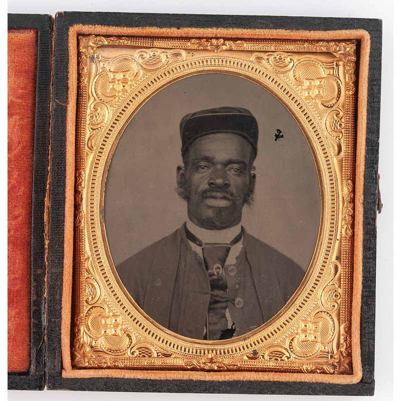 [AFRICAN AMERICANA] -- [PHOTOGRAPHY]. Sixth plate tintype of African American man wearing military-style cap. N.p., [ca 1860s-1870s].