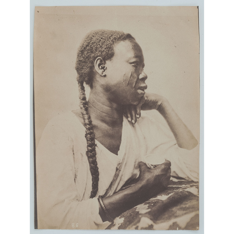 [AFRICAN AMERICANA] -- [EARLY PHOTOGRAPHY]. Portrait of black woman with scarred face. N.p., n.d.