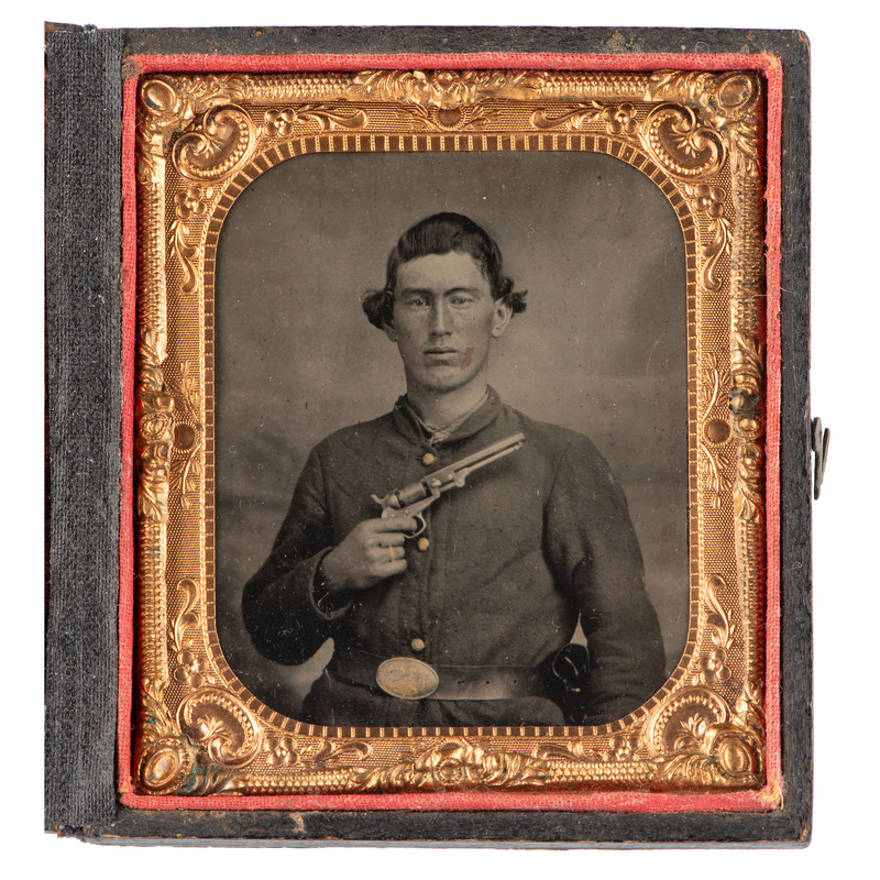 [CIVIL WAR]. Sixth plate tintype of Union soldier displaying his Colt revolver. N.p.: n.p., [1860s].