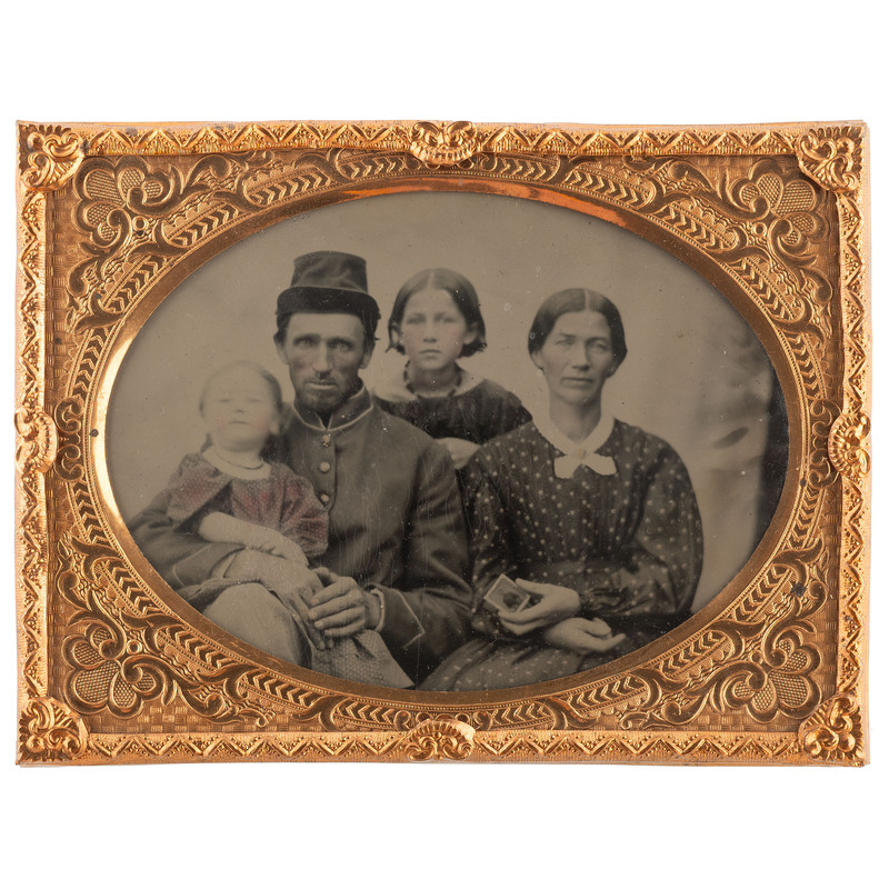 [CIVIL WAR - TINTYPE]. Quarter plate tintype of a soldier and his family. N.p., n.d.