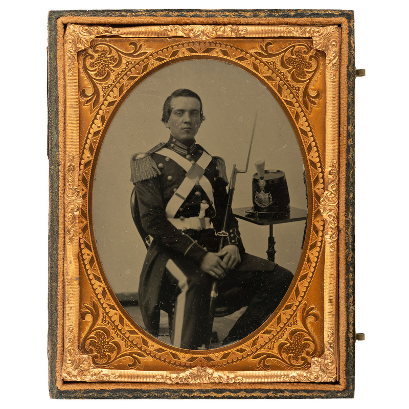 [CIVIL WAR]. Quarter plate ruby ambrotype of a 14th New York Militia private holding a bayonetted rifle. N.p., [ca 1860-1861].