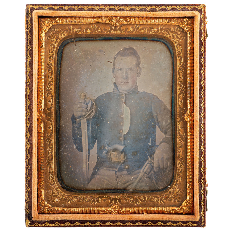 [CIVIL WAR]. Sixth plate daguerreotype of triple armed Union cavalry private. N.p.: n.p., [ca early 1860s].