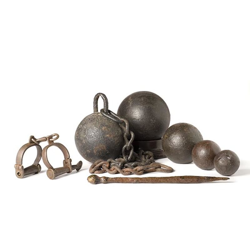 Lot of Five Cannonballs and Pair of Shackles,