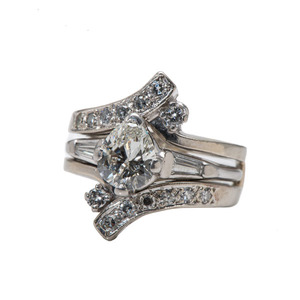 A Platinum and 14 Karat Gold Diamond Wedding Set