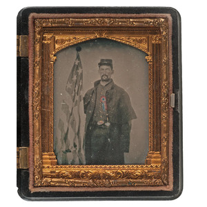 Civil War Ninth Plate Ambrotype of a Soldier Posed With the American Flag