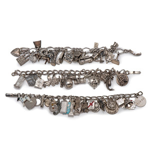 A Group of Three Sterling Charm Bracelets