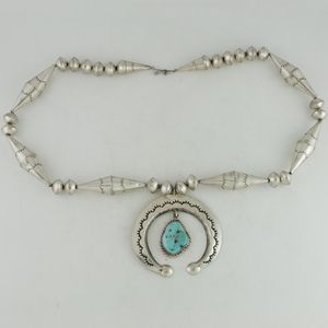 Navajo Stamped Silver Naja with Dangling Turquoise Pendant