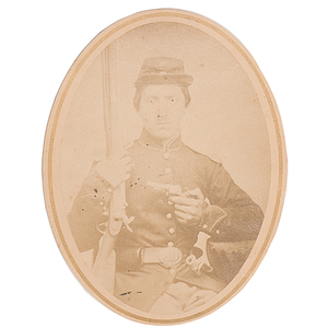 Civil War Oval Photograph of Soldier Armed with Sword and Pistol