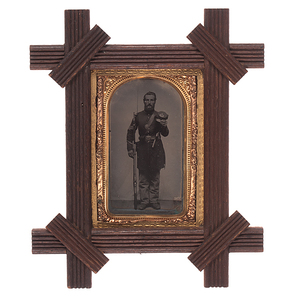Framed Tintype of a Heavily-Armed Union Sergeant Displaying his Kepi