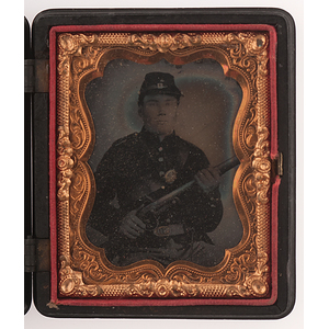 Cased Ninth Plate Tintype of an Armed Union Soldier Wearing an Upside-Down US Belt Buckle