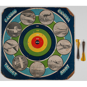 Lindstrom Tool & Toy Company Candid Camera Target Shot Game Board featuring 9 Aviation Photographs