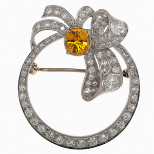 Circle and Bow Pin with Diamonds and Yellow Sapphire