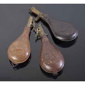Three Pressed Leather Shot Flasks,