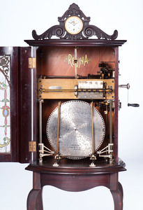 Rare Regina Model 35 Auto Changer 15.5 In. Disc Music Box with Clock and Original Leaded Glass Door
