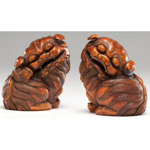 Chinese Carved Bamboo Models of Seated Lions