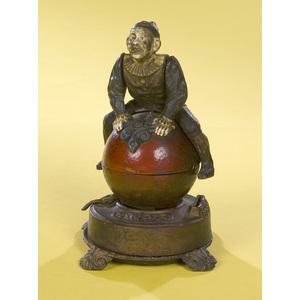Clown on Globe Cast Iron Mechanical Bank,