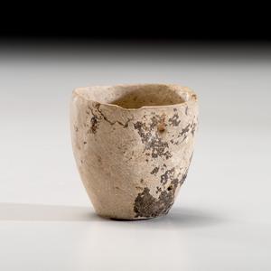An Archaic Limestone Cup, 2 in.