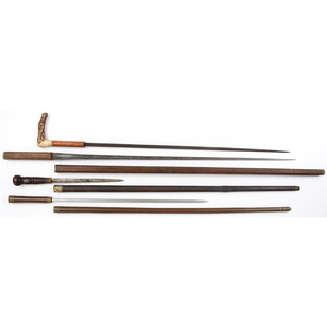 Lot of Four Sword Canes